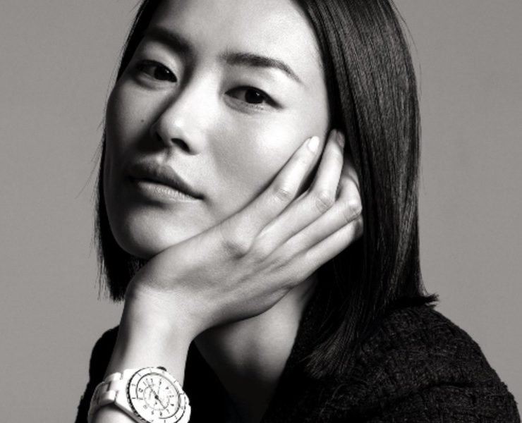 Chinese model Liu Wen posing with a white J12 watch. Image courtesy of Chanel